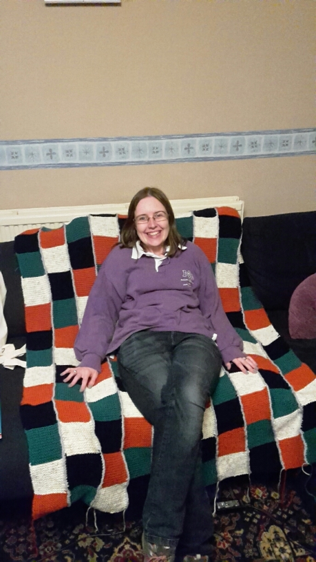 Rach sat on the finished blanket